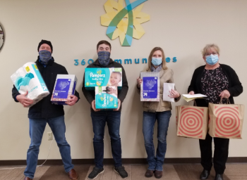 Lakeville employees with donated gifts